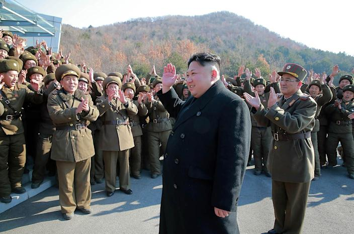 <p>This undated picture released by North Korea's Korean Central News Agency on March 7, 2017, shows North Korean leader Kim Jong Un waving to North Korean officers during the launch of four ballistic missiles by Korean People's Army (KPA) during a military drill at an undisclosed location in North Korea. Nuclear-armed North Korea launched four ballistic missiles on March 6 in another challenge to President Donald Trump, with three landing provocatively close to America's ally Japan. (AFP photo/KCNA via KNS/Getty Images) </p>