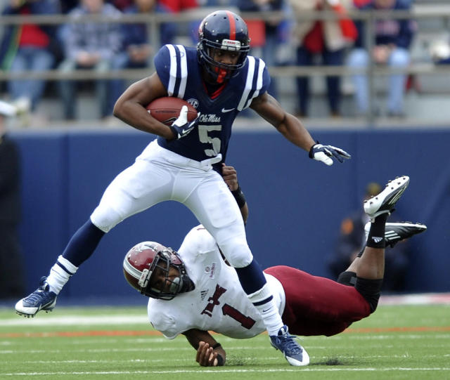 Mississippi running back I'Tavius Mathers (5) is tackled by Troy safety Camren Hudson (1) during an NCAA college football game in Oxford, Miss., Saturday, Nov. 16, 2013. (AP Photo/Oxford Eagle, Bruce Newman)