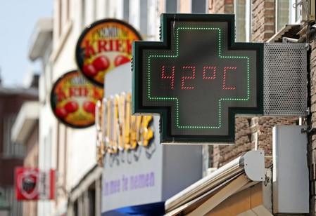 A temperature indicator outside of a pharmacy indicates 42 degres Celsius (107.6 Fahrenheit) in Brussels