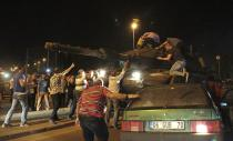 FILE - In this Friday, July 15, 2016 file photo, tanks move into position as Turkish people attempt to stop them, in Ankara, Turkey. Turkey is marking the fourth anniversary of the July 15 failed coup attempt against the government on Wednesday July 15, 2020, with ceremonies and events remembering its victims. (AP Photo/Burhan Ozbilici, File)