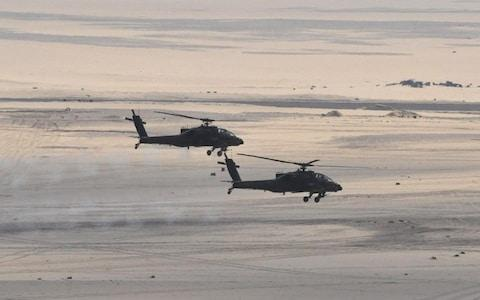 Egyptian Army's helicopters join the assault - Credit: Reuters