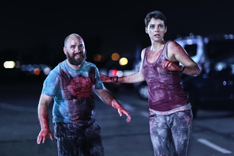 """This film publicity image released by Radius-TWC shows, Nicolas Martinez, left, and Andrea Osvart in a scene from """"Aftershock."""" (AP Photo/Radius-TWC)"""