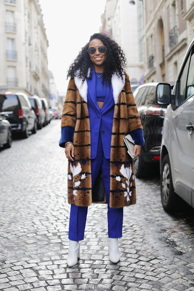 <p>Even in the colder months, show a little skin by styling a suiting set over a crop top instead of a classic button-down or blouse.</p>