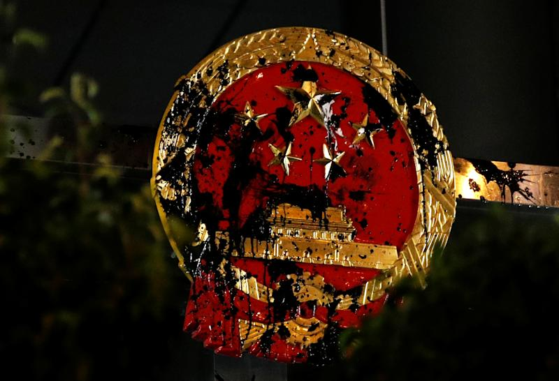 The National Emblem of the People's Republic of China is seen vandalised on the Chinese Liaison Office after a march to call for democratic reforms, in Hong Kong, China July 21, 2019. Picture taken July 21, 2019. (Photo: Edgar Su/Reuters)