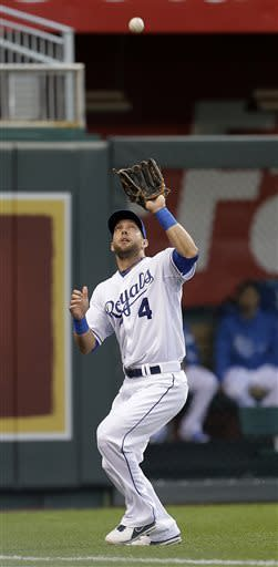 Kansas City Royals left fielder Alex Gordon catches a fly ball hit by Minnesota Twins' Ryan Doumit during the first inning of a baseball game Wednesday, June 5, 2013, in Kansas City, Mo. (AP Photo/Charlie Riedel)