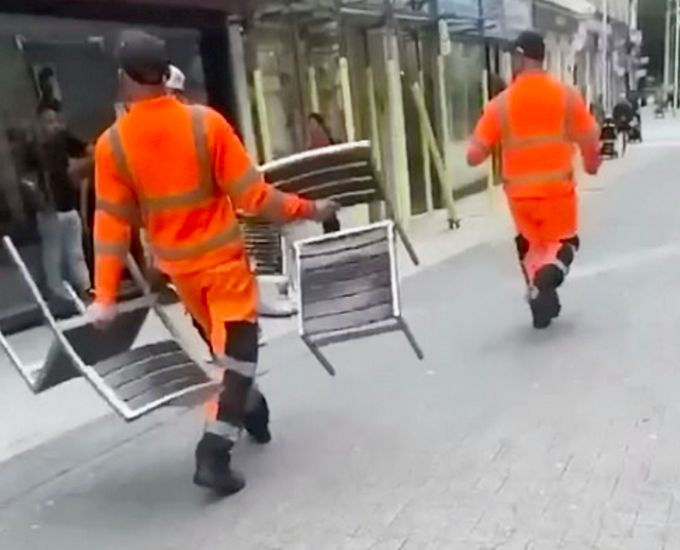 A witness said the binmen were throwing  outdoor chairs at random people as the incident escalated. (SWNS)