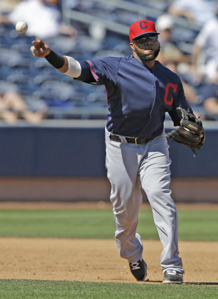 Cleveland Indians' Carlos Santana throws out San Diego Padres' Will Venable during the third inning of an exhibition spring training baseball game Saturday, March 8, 2014, in Peoria, Ariz. (AP Photo/Darron Cummings)