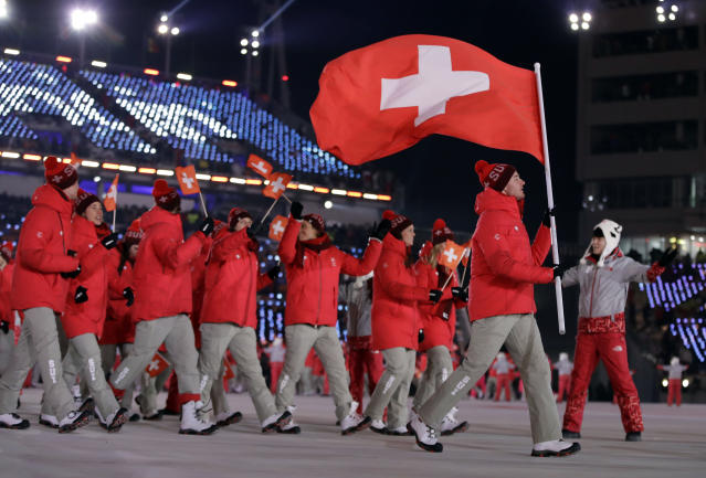 <p>Dario Cologna holds up the flag of Switzerland during the opening ceremony of the 2018 Winter Olympics in Pyeongchang, South Korea, Friday, Feb. 9, 2018. (AP Photo/Vadim Ghirda) </p>