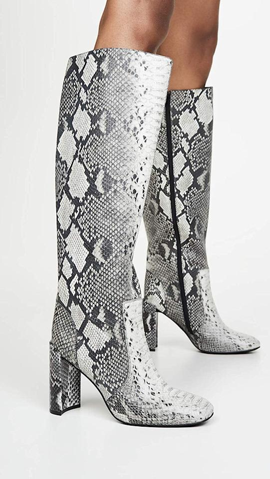 "<p>These <a href=""https://www.popsugar.com/buy/Jeffrey-Campbell-Entuit-Tall-Boots-499709?p_name=Jeffrey%20Campbell%20Entuit%20Tall%20Boots&retailer=amazon.com&pid=499709&price=179&evar1=fab%3Aus&evar9=44001001&evar98=https%3A%2F%2Fwww.popsugar.com%2Ffashion%2Fphoto-gallery%2F44001001%2Fimage%2F46742909%2FJeffrey-Campbell-Entuit-Tall-Boots&list1=shopping%2Cfall%20fashion%2Camazon%2Cshoes%2Cboots%2Cfall&prop13=mobile&pdata=1"" rel=""nofollow"" data-shoppable-link=""1"" target=""_blank"" class=""ga-track"" data-ga-category=""Related"" data-ga-label=""https://www.amazon.com/Jeffrey-Campbell-Womens-Entuit-Medium/dp/B07WWHP4ZF?s=shopbop&amp;ref_=sb_ts"" data-ga-action=""In-Line Links"">Jeffrey Campbell Entuit Tall Boots</a> ($179, originally $255) look great with midi dresses.</p>"