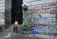 Graffiti being cleaned up in New York in July