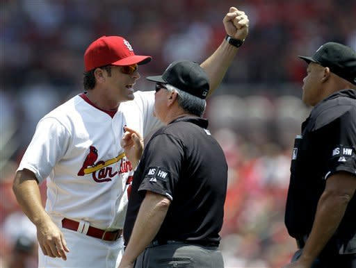 St. Louis Cardinals manager Mike Matheny, left, argues with umpires Dana DeMuth, center, and Kerwin Danley during the first inning of a baseball game against the Kansas City Royals on Saturday, June 16, 2012, in St. Louis. Matheny was thrown out of the game by Danley. (AP Photo/Jeff Roberson)
