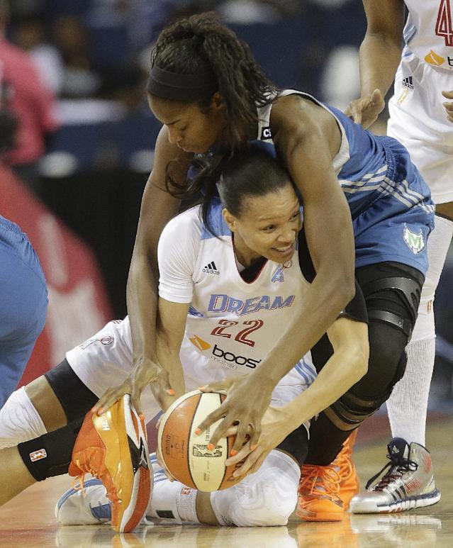 Minnesota Lynx' Devereaux Peters (14) vies for a loose ball against Atlanta Dream's Armintie Herrington (22) during the first half of Game 3 of the WNBA Finals basketball game in Duluth, Ga., Thursday, Oct. 10, 2013. (AP Photo/John Bazemore)