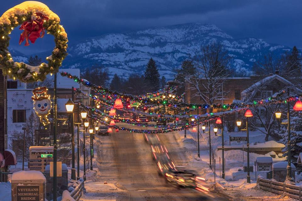 """<p>Whitefish kicks off its holiday celebrations at the beginning of December with the town's <a href=""""https://www.whitefishchamber.org/christmas-stroll/"""" rel=""""nofollow noopener"""" target=""""_blank"""" data-ylk=""""slk:Christmas Stroll"""" class=""""link rapid-noclick-resp"""">Christmas Stroll</a>. Its residents come out to Central Ave., smack in the middle of downtown, for caroling, eating, and drinking. You'll see fire dancers perform, hear a local music school's students sing, and go Turkey Bowling with the Winter Carnival Royalty. </p>"""