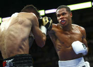Devin Haney, right, punches Jorge Linares during the WBC lightweight title boxing match Saturday, May 29, 2021, in Las Vegas. (AP Photo/Chase Stevens)