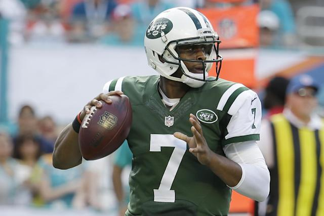 New York Jets quarterback Geno Smith (7) looks to pass during the first half of an NFL football game against the Miami Dolphins, Sunday, Dec. 28, 2014, in Miami Gardens, Fla. The Jets defeated the Dolphins 37-24. (AP Photo/Lynne Sladky)