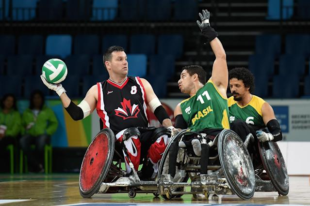 RIO DE JANEIRO, BRAZIL - FEBRUARY 26: Julio Cesar Braz of Brazil competes against Micheal Whitehead of Canada during the International Wheelchair Rugby Championship - Aquece Rio Test Event for the Rio 2016 Paralympics match between Brazil and Canada at Olympic Park on February 26, 2016 in Rio de Janeiro, Brazil. (Photo by Buda Mendes/Getty Images)