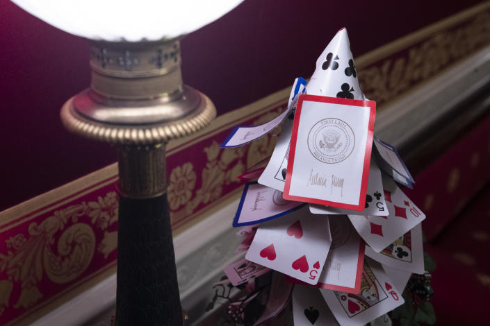 The Red Room is decorated with games, including a tree made of White House playing cards during the 2019 Christmas preview at the White House, Monday, Dec. 2, 2019, in Washington. | AP—Copyright 2019 The Associated Press. All rights reserved.