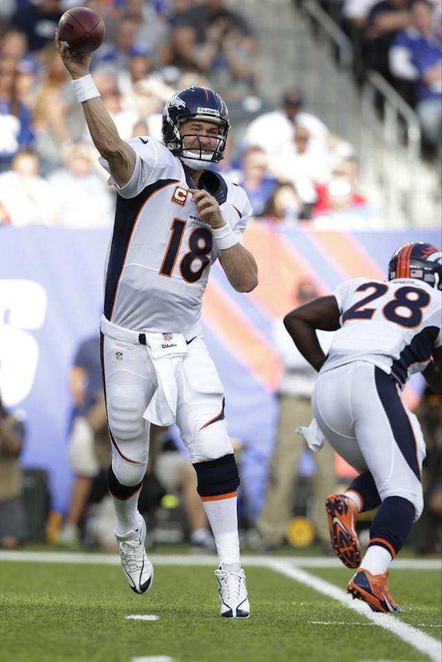 Denver Broncos quarterback Peyton Manning (18) throws a pass during the first half of an NFL football game against the New York Giants Sunday, Sept. 15, 2013, in East Rutherford, N.J. (AP Photo/Kathy Willens)