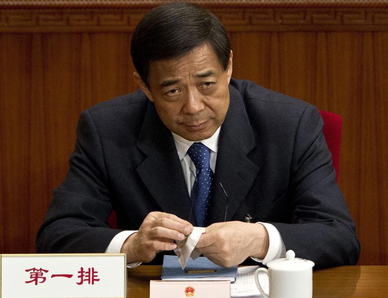 FILE - In this March 11, 2012 file photo, then Chongqing party secretary Bo Xilai attends a plenary session of the National People's Congress at the Great Hall of the People in Beijing. Bo's wife Gu Kailai who is accused of murdering Bo family associate Neil Heywood went on trial Thursday, Aug. 9, 2012 at the Hefei Intermediate People's Court in eastern China. Bo was already in the Communist Party's 25-member Politburo and before the scandal was seen as a contender for the nine-member Standing Committee that runs China. (AP Photo/Andy Wong, File)