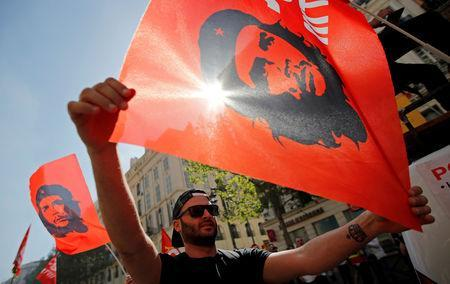 "Workers wave CGT labour union flags with an image of revolutionary hero Ernesto ""Che"" Guevara during a demonstration against the French government's reform plans in Marseille as part of a national day of protest, France, April 19, 2018. REUTERS/Jean-Paul Pelissier/File Photo"
