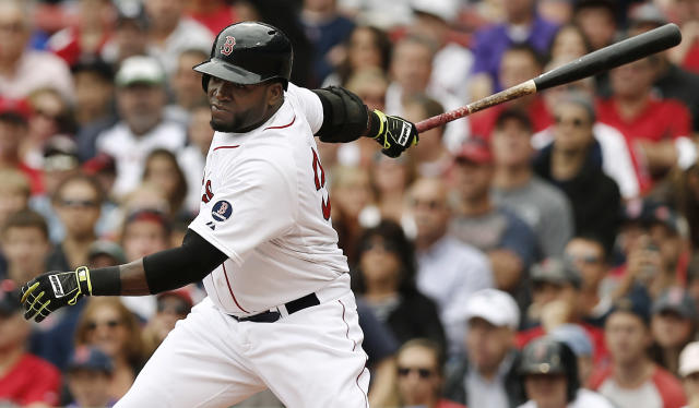 Boston Red Sox designated hitter David Ortiz follows through with an RBI single during the third inning of a baseball game against the New York Yankees at Fenway Park in Boston Saturday, Sept. 14, 2013. (AP Photo/Winslow Townson)