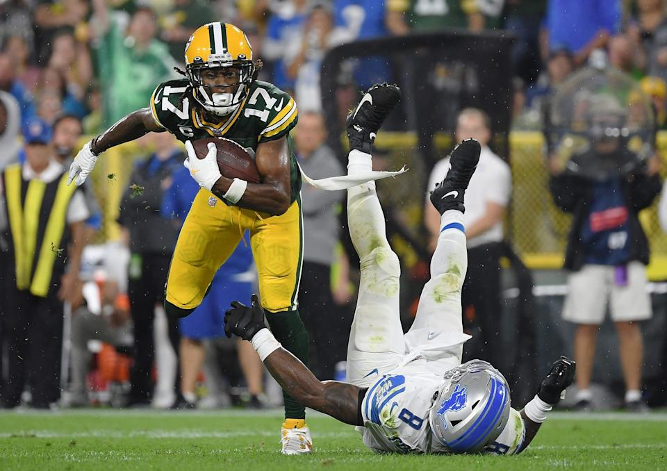 Davante Adams #17 of the Green Bay Packers runs against Jamie Collins #8 of the Detroit Lions during the second half at Lambeau Field on Monday, Sept. 20, 2021 in Green Bay, Wisconsin.