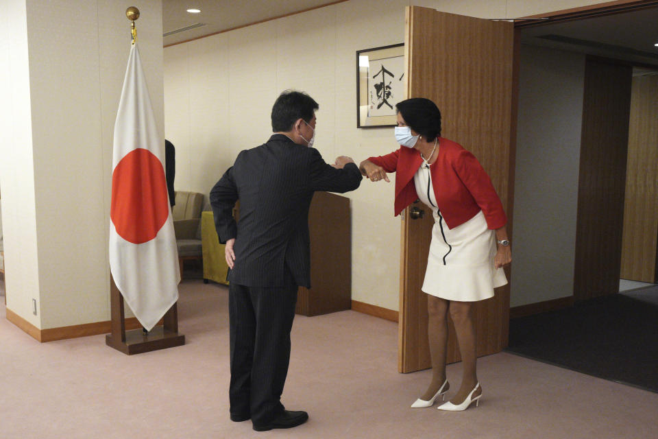 United Nations Secretary General's Special Envoy to Myanmar Christine Schraner Burgener, right, and Japan's Foreign Minister Toshimitsu Motegi, left, greet prior to a courtesy call at the Ministry of Foreign Affairs Friday, May 28, 2021, in Tokyo. (AP Photo/Eugene Hoshiko, Pool)