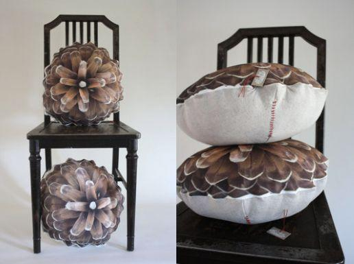 """""""This pinecone pillow is the perfect addition for any aspiring cabin owner,"""" Johnson says. <a href=""""https://www.etsy.com/listing/169145197/pine-cone-pillow-made-to-order?ref="""" target=""""_blank"""">Shop them here</a>."""