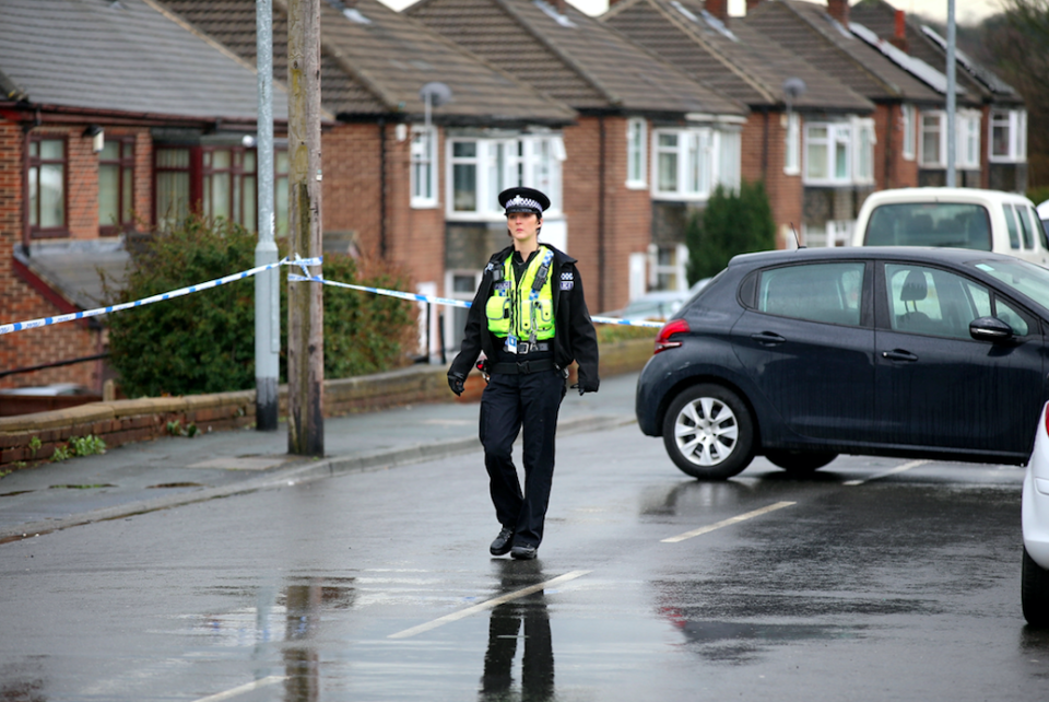 <em>A police cordon remains in place while officers conduct their investigation (SWNS)</em>