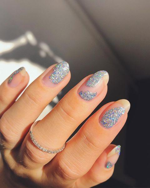 """<p>To make your glitter polish look modern and mature, apply it in this abstract, blotted pattern. </p><p><a href=""""https://www.instagram.com/p/CHyiO0qjsBJ/&hidecaption=true"""" rel=""""nofollow noopener"""" target=""""_blank"""" data-ylk=""""slk:See the original post on Instagram"""" class=""""link rapid-noclick-resp"""">See the original post on Instagram</a></p>"""
