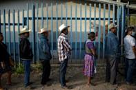 Mexicans queue to vote at a polling station in Atzacoaloya in the southern state of Guerrero
