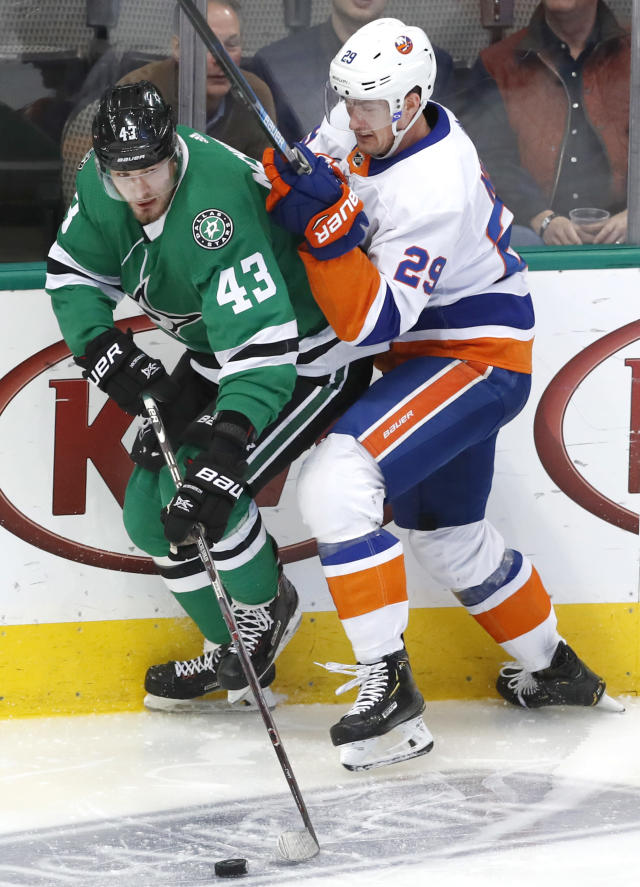New York Islanders center Brock Nelson (29) and Dallas Stars right wing Valeri Nichushkin (43) vie for control of the puck during the first period of an NHL hockey game in Dallas, Sunday, Dec. 23, 2018. (AP Photo/LM Otero)