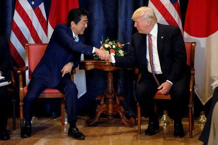 U.S. President Trump and Japan's PM Abe shake hands during a bilateral meeting at the G7 summit in Taormina