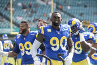Los Angeles Rams defensive end Aaron Donald (99) defensive end Michael Brockers (90) and nose tackle Sebastian Joseph-Day (69) prepare for an NFL game against the Miami Dolphins, Sunday, Nov. 1, 2020 in Miami Gardens, Fla. The Dolphins defeated the Rams 28-17. (Margaret Bowles via AP)