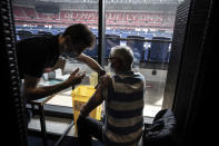 Patients receive an injection of the Moderna Covid-19 vaccine on the opening day of a mass vaccination centre set up in the Olympique Lyonnais soccer Stadium, in Decines-Charpieu, Saturday, April 3, 2021. (Jean-Philippe Ksiazek, Pool via AP)