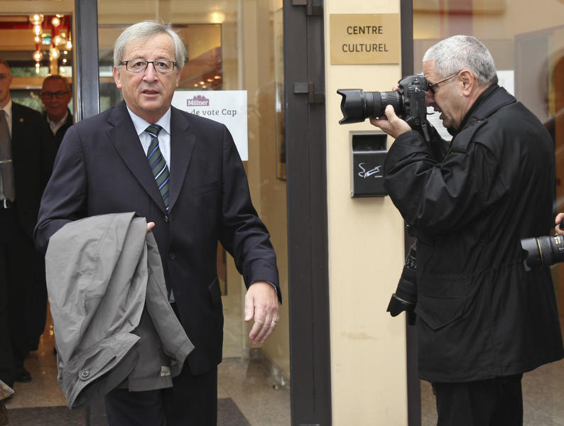 Luxembourg's Prime Minister Jean-Claude Juncker walks out a polling station in Capellen, Luxembourg, Sunday Oct. 20, 2013. Polls opened in Luxembourg for legislative elections on Sunday, with Prime Minister Juncker hoping to win another term in office after an intelligence scandal brought down his government earlier this year. Juncker is the European Union's longest-serving premier after 18 years in office. (AP Photo/Yves Logghe)
