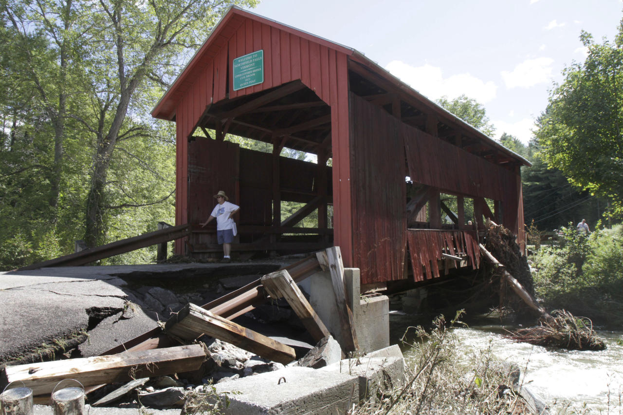 A damaged historic covered bridge spans Cox Brook in Northfield, Vt., Monday, Aug. 29, 2011, the day after Tropical Storm Irene dumped heavy rainfall across the region, causing flash floods. (AP Photo/Toby Talbot)