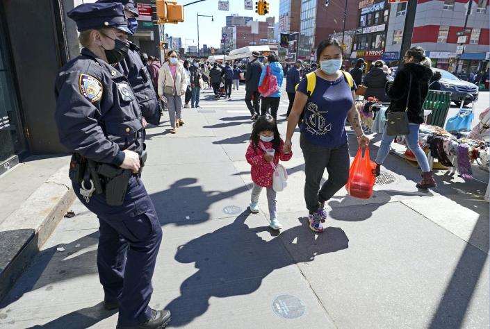 """<span class=""""caption"""">As fears of anti-Asian violence grow, police seek to be more visible to deter attacks.</span> <span class=""""attribution""""><a class=""""link rapid-noclick-resp"""" href=""""https://newsroom.ap.org/detail/AsianAmericanWomanAssaulted/60ae76c2abdb41eaa98618403dcb2a44/photo"""" rel=""""nofollow noopener"""" target=""""_blank"""" data-ylk=""""slk:AP Photo/Kathy Willens"""">AP Photo/Kathy Willens</a></span>"""