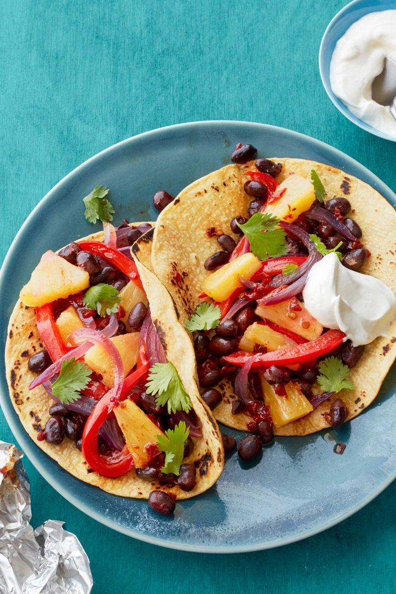 """<p>Mexican <a href=""""https://www.womansday.com/food-recipes/food-drinks/g2373/vegetarian-recipes/"""" rel=""""nofollow noopener"""" target=""""_blank"""" data-ylk=""""slk:goes meatless"""" class=""""link rapid-noclick-resp"""">goes meatless</a> with these sweet and smoky vegetarian fajitas.</p><p><em><a href=""""https://www.womansday.com/food-recipes/food-drinks/recipes/a55764/pineapple-and-black-bean-fajitas-recipe/"""" rel=""""nofollow noopener"""" target=""""_blank"""" data-ylk=""""slk:Get the Pineapple and Black Bean Fajitas recipe."""" class=""""link rapid-noclick-resp"""">Get the Pineapple and Black Bean Fajitas recipe.</a></em></p>"""