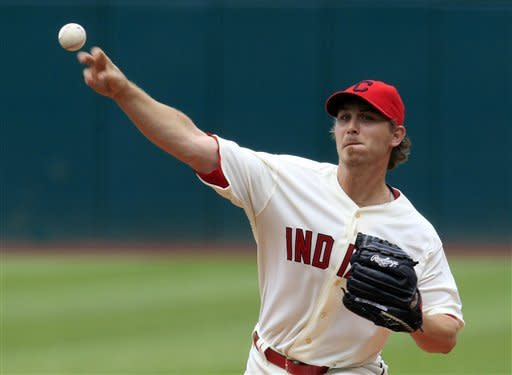 Cleveland Indians starting pitcher Josh Tomlin delivers in the first inning of a baseball game against the Baltimore Orioles, Sunday, July 22, 2012, in Cleveland. (AP Photo/Tony Dejak)