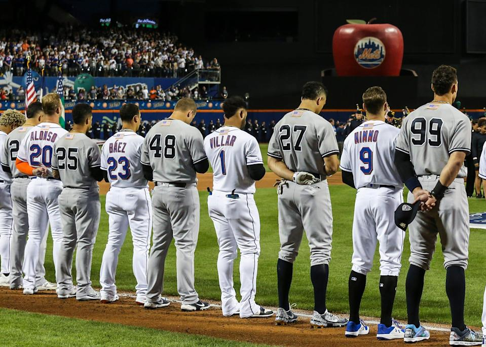 Mets and Yankees players line up during ceremonies prior to the game on Sept. 11 at Citi Field.