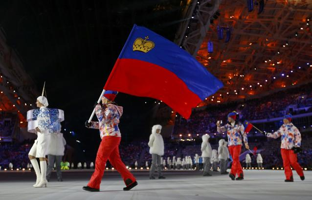 Liechtenstein's flag-bearer Tina Weirather leads her country's delegation during the opening ceremony of the 2014 Sochi Winter Olympic Games at Fisht stadium February 7, 2014. REUTERS/Brian Snyder (RUSSIA - Tags: OLYMPICS SPORT)