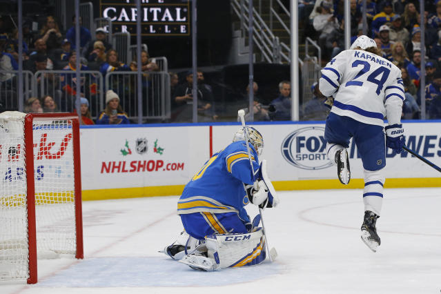Toronto Maple Leafs' Kasperi Kapanen, of Finland, screens St. Louis Blues goaltender Jordan Binnington on a shot for a goal by Jason Spezza (not pictured) during the first period of an NHL hockey game Saturday, Dec. 7, 2019, in St. Louis. (AP Photo/Billy Hurst)