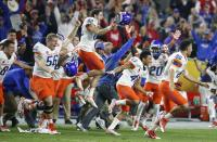 Boise State players and coaches run on the field as they celebrate their win as time expires in the second half of the Fiesta Bowl NCAA college football game against Arizona Wednesday, Dec. 31, 2014, in Glendale, Ariz. Boise State defeated 38-30. (AP Photo/Ross D. Franklin)