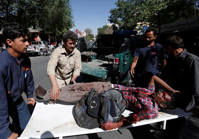 <p>Men move an injured man to a hospital after a blast in Kabul, Afghanistan May 31, 2017. (Mohammad Ismail/Reuters) </p>
