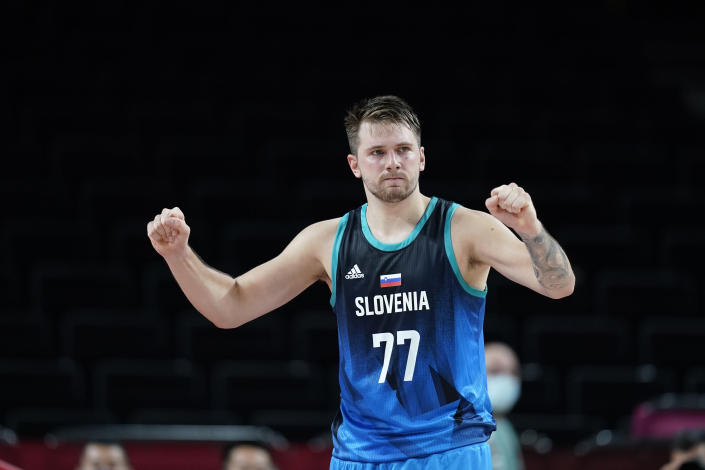 Slovenia's Luka Doncic celebrates at the end of a men's basketball preliminary round game against Spain at the 2020 Summer Olympics, Sunday, Aug. 1, 2021, in Saitama, Japan. (AP Photo/Charlie Neibergall)