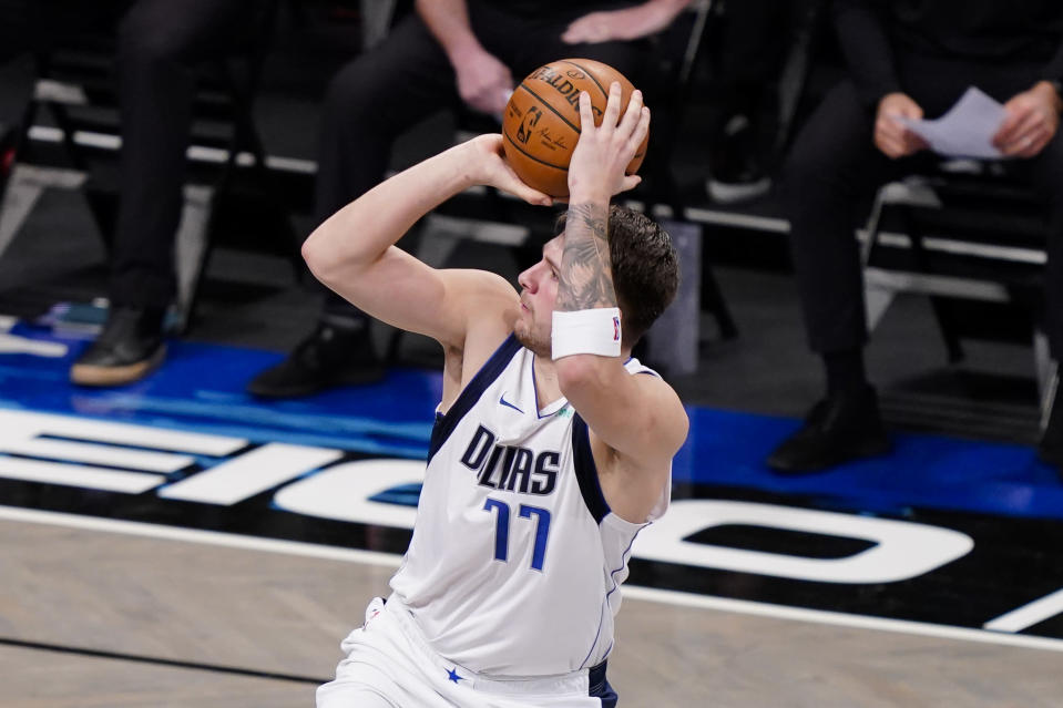 Dallas Mavericks guard Luka Doncic shoots during the second half of the team's NBA basketball game against the Brooklyn Nets, Saturday, Feb. 27, 2021, in New York. (AP Photo/John Minchillo)