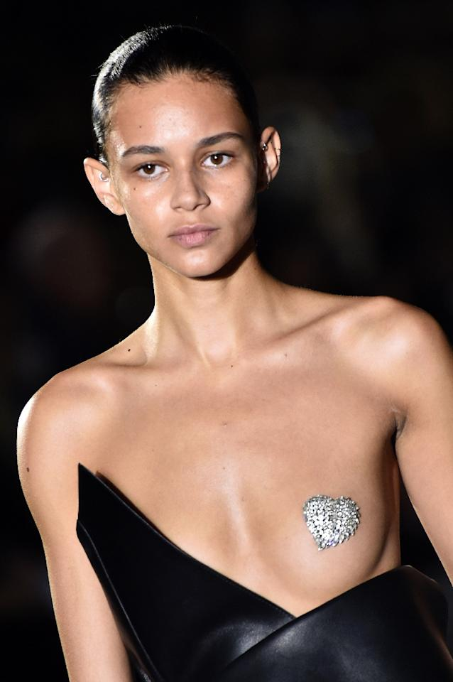 A model presents the mono boob dress for Saint Laurent during the 2017 Spring/Summer ready-to-wear collection fashion show, on September 27, 2016 in Paris (AFP Photo/Bertrand Guay)