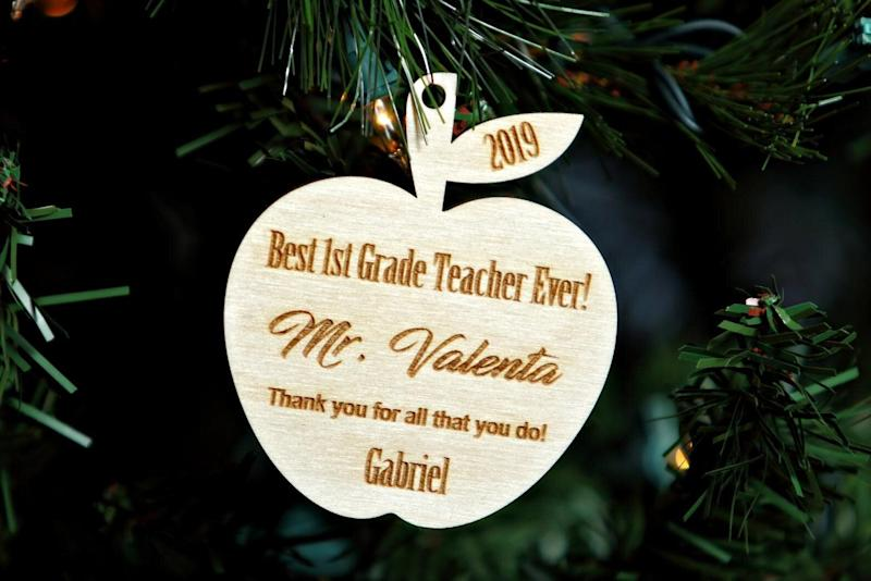 "What's more adorable than an engraved Christmas ornament from a kid? Get it for $11.01 at <a href=""https://www.etsy.com/ca/listing/758484335/teacher-christmas-ornament-personalized"" target=""_blank"" rel=""noopener noreferrer"">Etsy</a>.&nbsp;"