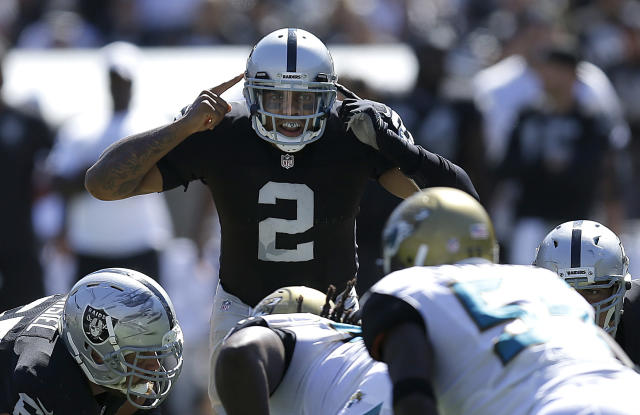 Oakland Raiders quarterback Terrelle Pryor (2) signals at the line of scrimmage during the second quarter of an NFL football game against the Jacksonville Jaguars in Oakland, Calif., Sunday, Sept. 15, 2013. (AP Photo/Ben Margot)